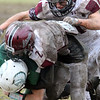 Billerica vs Chelmsford Thanksgiving Day football. Chelmsford's Liam Gilet (2) and Nikolas Sperounis (21) tackle Billerica's Nick Gualtieri (25). (SUN/Julia Malakie)