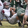 Billerica vs Chelmsford Thanksgiving Day football. Chelmsford's Brett Baker (1) tackled by Billerica's Andrew Knight (79). (SUN/Julia Malakie)