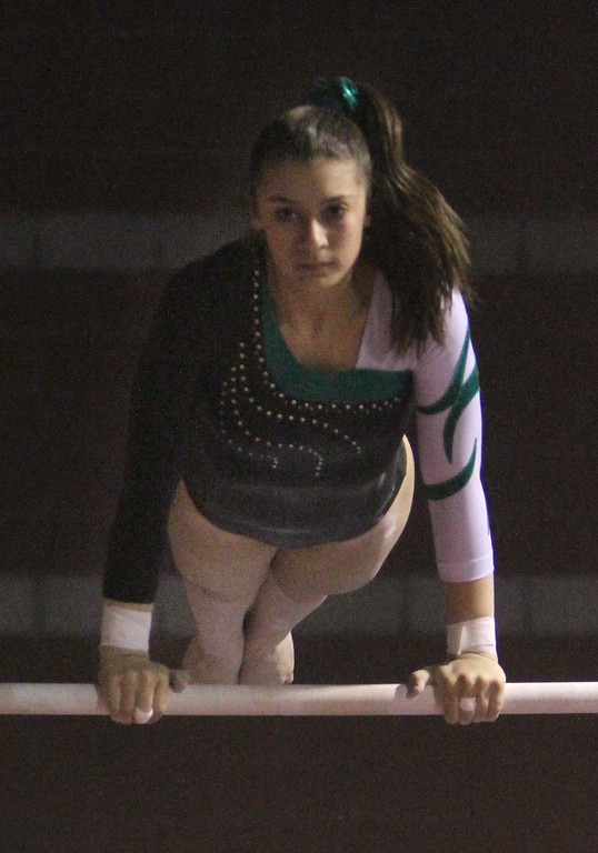 . Billerica and Chelmsford gymnastics in tri-meet vs Haverhill. Kerra Lipman of Billerica on Parallel Bars. (SUN/Julia Malakie)