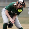 Billerica vs Chelmsford softball. Billerica starting pitcher Jackie Holden (11) tries to get hold of a ground ball in the top of the second inning. She made the throw to first for an out. (SUN/Julia Malakie)