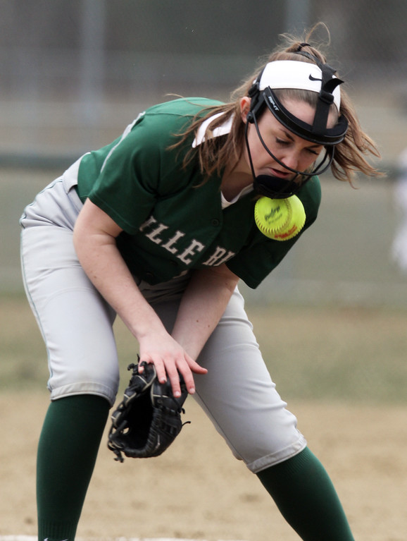 . Billerica vs Chelmsford softball. Billerica starting pitcher Jackie Holden (11) tries to get hold of a ground ball in the top of the second inning. She made the throw to first for an out. (SUN/Julia Malakie)