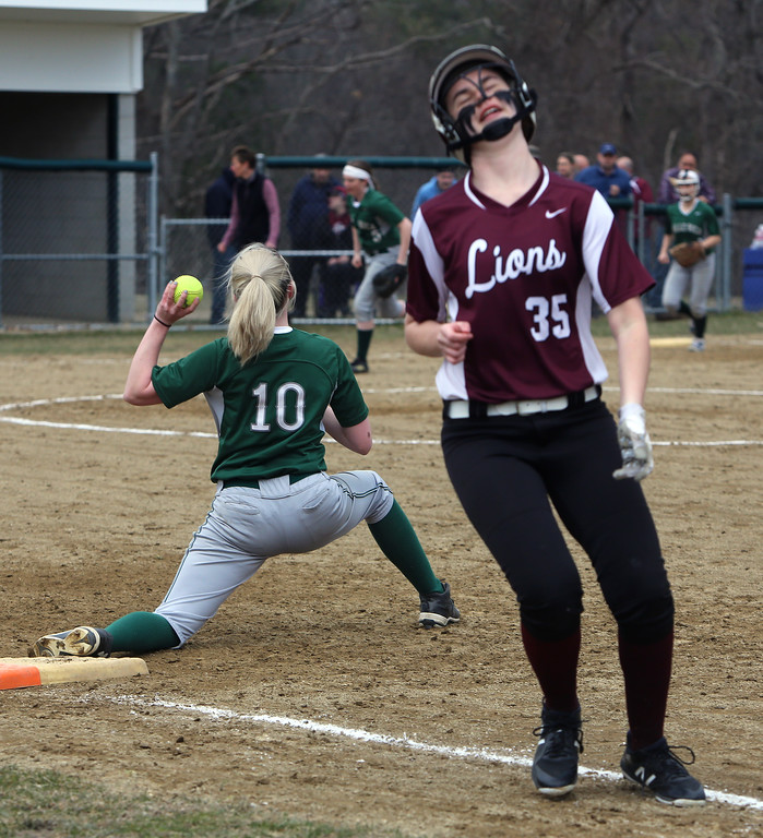 . Billerica vs Chelmsford softball. Chelmsford\'s Emma Gelineau (35) is out on a ground ball in the top of the third inning, with Billerica first baseman Jacquie Schwalm (10) fielding the throw. (SUN/Julia Malakie)