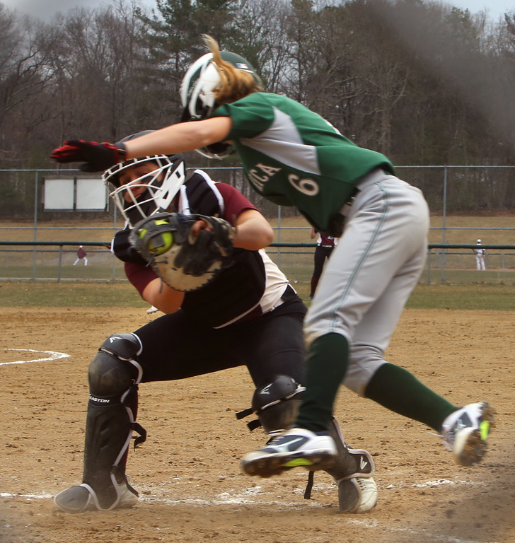 . Billerica vs Chelmsford softball. Billerica\'s Bella Tassone (6) is tagged out at home by Chelmsford catcher Sydney Alto (9) in the bottom of the first inning. (SUN/Julia Malakie)