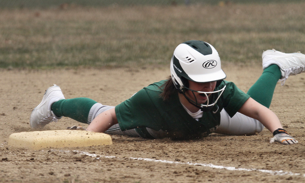 . Billerica vs Chelmsford softball. Billerica\'s Abby Iozzo (8) is safe at third on a double by Bella Tassone in the bottom of the first inning. (SUN/Julia Malakie)