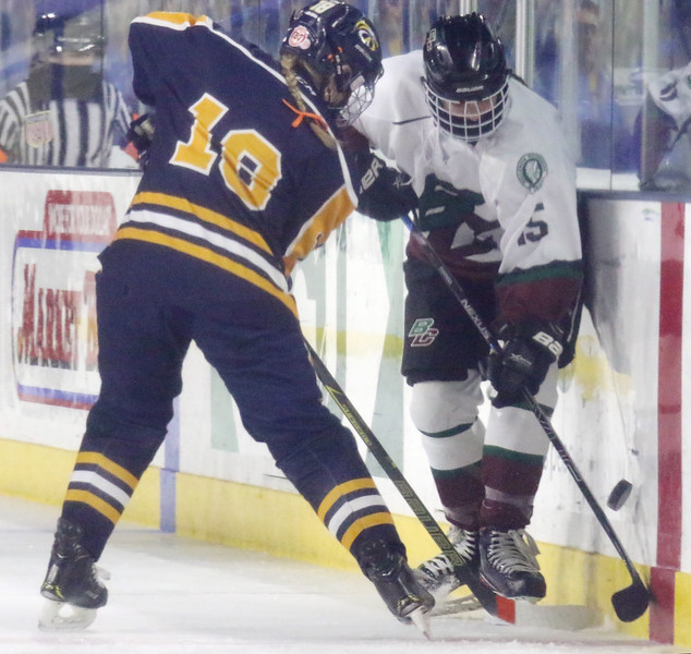 Billerica/Chelmsford vs Andover girls hockey in Merrimack Valley Conference championship. Andover's Jacqueline Haney (18) and B/C's Samantha Fantasia (15). (SUN/Julia Malakie)
