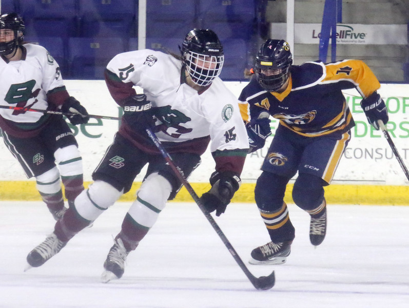 Billerica/Chelmsford vs Andover girls hockey in Merrimack Valley Conference championship. B/C's Samantha Fantasia (15) and Andover's Ashley Chiango (11).  (SUN/Julia Malakie)