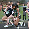 Billerica vs Dracut track meet. Start of Girls 100 Meters, from left, Taylor Gibson of Billerica, Skyla Murray of Dractu, Leithsa Dimanche of Billerica and Ava Soucy of Dracut. (SUN/Julia Malakie)