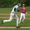 Billerica vs Tewksbury baseball. After reaching third on a throw that got by the fielder, Billerica's Brady McGarry (7) heads for home as Tewksbury third baseman Mike Polimeno (11) urges a throw to the plate, where McGarry was tagged out. (SUN/Julia Malakie)
