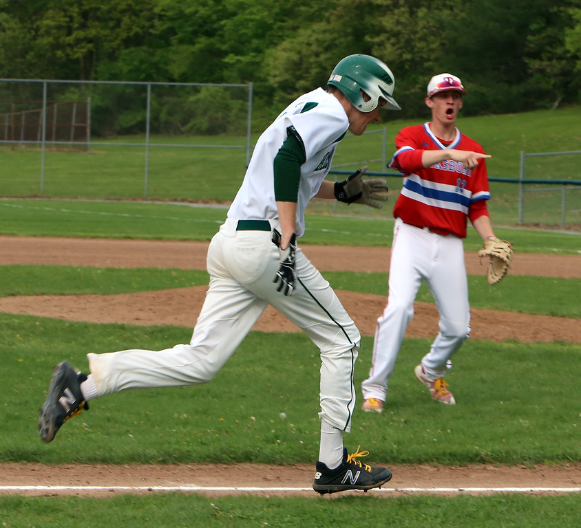 . Billerica vs Tewksbury baseball. After reaching third on a throw that got by the fielder, Billerica\'s Brady McGarry (7) heads for home as Tewksbury third baseman Mike Polimeno (11) urges a throw to the plate, where McGarry was tagged out. (SUN/Julia Malakie)