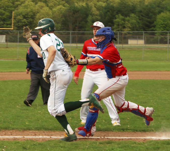 Billerica vs Tewksbury baseball. Billerica's Ryan Murphy (20) is caught in a rundown by Tewksbury catcher Ryne Rametta (9) in the bottom of the fifth inning. (SUN/Julia Malakie)