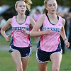 Billerica hosts cross country meet with Tewksbury and North Andover, at Vietnam Veterans Park. Meghan Ostertag (who finished 4th), left, and Holly O'Leary (3rd), late in the race. (SUN/Julia Malakie)