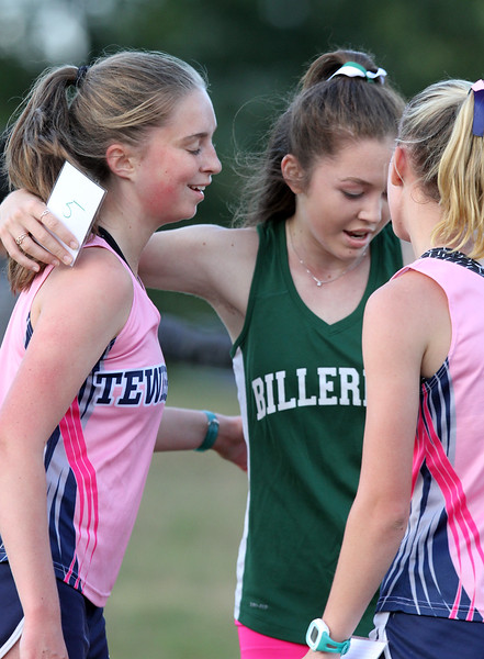 Billerica hosts cross country meet with Tewksbury and North Andover, at Vietnam Veterans Park. From left, Holly O'Leary of Tewksbury, who finished 3rd, Hannah Doherty of Billerica (5th) and Meghan Ostertag of Tewksbury (4th). (SUN/Julia Malakie)