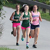 Billerica hosts cross country meet with Tewksbury and North Andover, at Vietnam Veterans Park. In middle of race, from left: Nicole Anderson and Hannah Doherty of Billerica, and Rachel Sessa of Tewksbury, the eventual winner. (SUN/Julia Malakie)