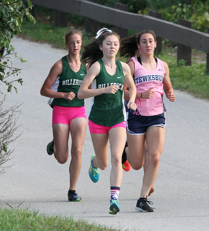 . Billerica hosts cross country meet with Tewksbury and North Andover, at Vietnam Veterans Park. In middle of race, from left: Nicole Anderson and Hannah Doherty of Billerica, and Rachel Sessa of Tewksbury, the eventual winner. (SUN/Julia Malakie)