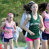Billerica hosts cross country meet with Tewksbury and North Andover, at Vietnam Veterans Park. In middle of race, from left: Makayla Paige of Tewksbury (2nd place finisher), Hannah Doherty of Billerica (5th place),  and Rachel Sessa of Tewksbury, the eventual winner. (SUN/Julia Malakie)