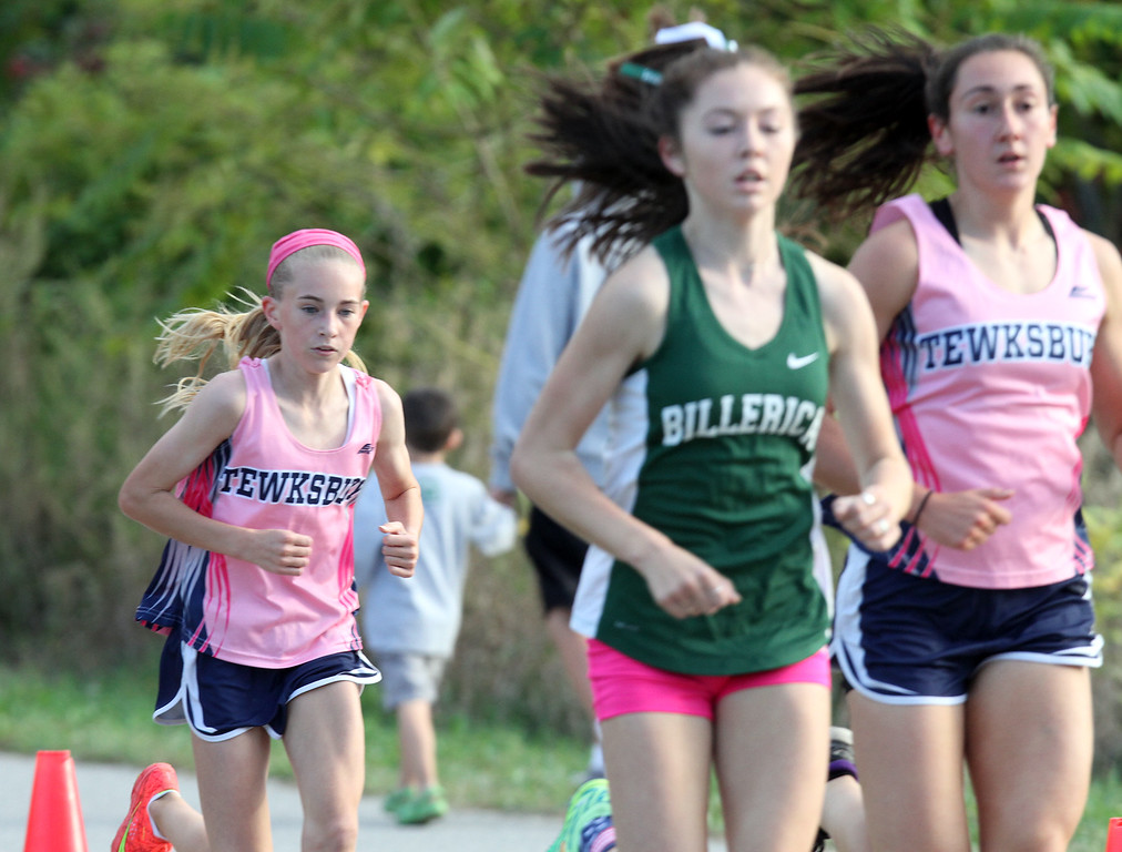 . Billerica hosts cross country meet with Tewksbury and North Andover, at Vietnam Veterans Park. In middle of race, from left: Makayla Paige of Tewksbury (2nd place finisher), Hannah Doherty of Billerica (5th place),  and Rachel Sessa of Tewksbury, the eventual winner. (SUN/Julia Malakie)