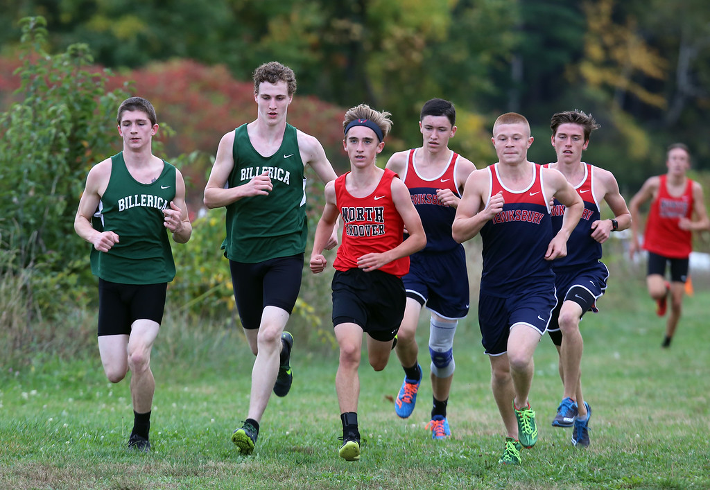 . Billerica hosts cross country meet with Tewksbury and North Andover, at Vietnam Veterans Park. From left, Shawn Stairs and Jacob Loftin of Billerica, Jack Bicksler of North Andover, and Pat Carleton, Alec Hirtle and Joey Forest of Tewksbury, in the middle of the race. (SUN/Julia Malakie)