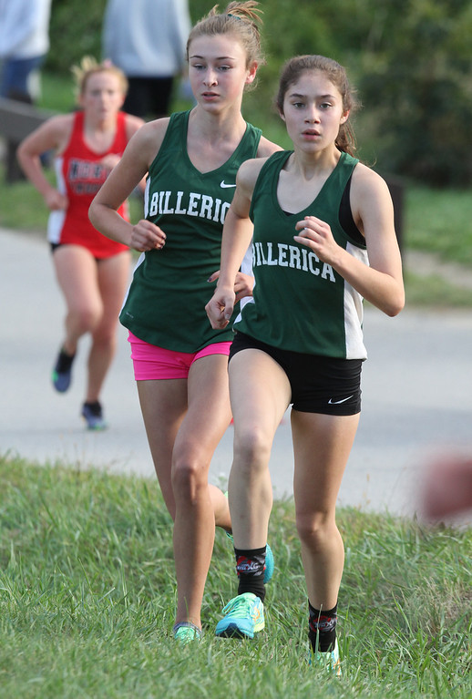 . Billerica hosts cross country meet with Tewksbury and North Andover, at Vietnam Veterans Park. Kayley Mace, left, and Danielle Sullivan, of Billerica, in middle of the race. (SUN/Julia Malakie)