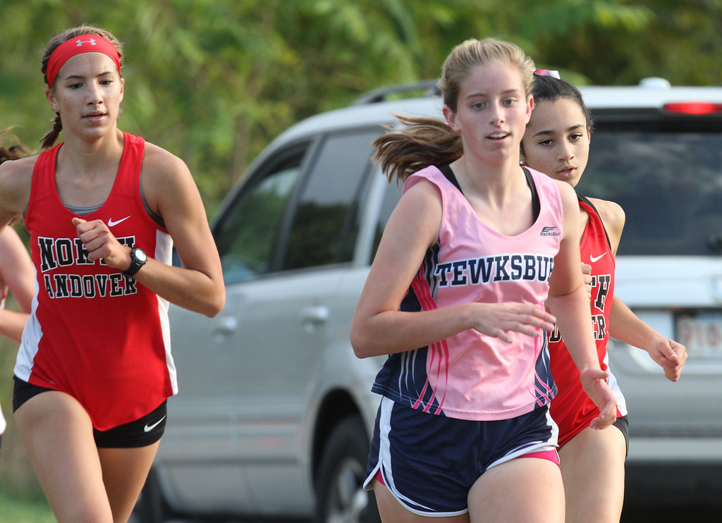 . Billerica hosts cross country meet with Tewksbury and North Andover, at Vietnam Veterans Park. Devyn Veits of Tewksbury, center, and Jamie Plodzik, left, and Tina Fleury, right, of North Andover. (SUN/Julia Malakie)