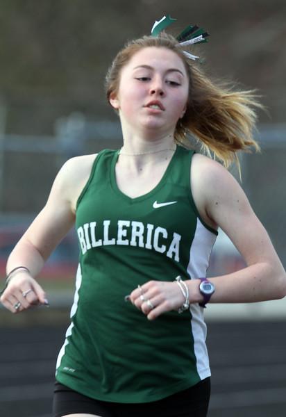 Billerica vs Tewksbury track & field. Billerica's Hannah Doherty in girls 2 Mile, which she won. (SUN/Julia Malakie)