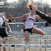 Billerica vs Tewksbury track & field. Girls 110 hurdles runners including Isabelle Frost of Tewksbury, keep running even though officials tried to stop the heat due to stopwatches not having been set in time for the start. (SUN/Julia Malakie)