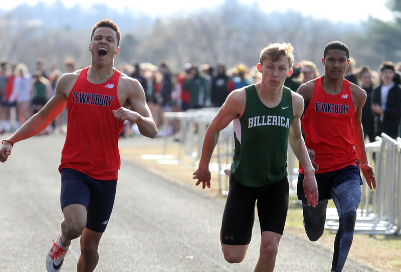 Billerica vs Tewksbury track & field. From left, Tewksbury's Colby Wilson wins boys 100, followed by Billerica's Ryan D'Agostino, 2nd, and Tewksbury's Neftali Mercedes, 3rd. (SUN/Julia Malakie)