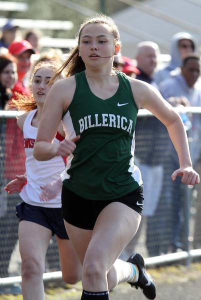 Billerica vs Tewksbury track & field. Billerica's Olivia Cameron wins girls 100. (SUN/Julia Malakie)