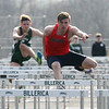 Billerica vs Tewksbury track & field. Tewksbury's Zach LaLonde, on his way to winning boys 110 hurdles. At left is Ian Moore of Billerica. (SUN/Julia Malakie)