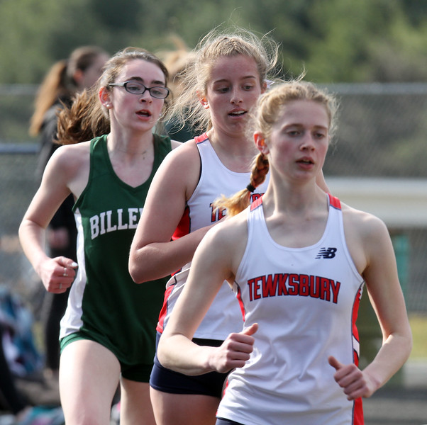 Billerica vs Tewksbury track & field. In girls 2 Mile, from left, Billerica's Cassidy Elliot, who finished 3rd, and Tewksbury's Devyn Veits, 4th, and Lily Robinson, 2nd. (SUN/Julia Malakie)