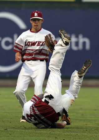 Lowell vs Billerica in finals of Spinners Cub baseball. Lowell shortstop Dawy Lebron (13) falls backwards backing up for a pop fly but hangs onto the ball to end the top of the second inning, as left fielder Dan Smith (10) looks on.  (SUN/Julia Malakie)