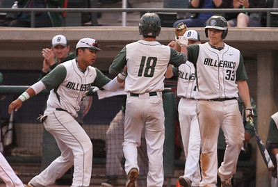 Lowell vs Billerica in finals of Spinners Cub baseball. Billerica's Justin Burek (18) scores on a sacrifice fly in the top of the second inniing to give Billerica a 3-0 lead, greeted by Kyle Cortese (24), left, and Alex Cruwys (33).  (SUN/Julia Malakie)
