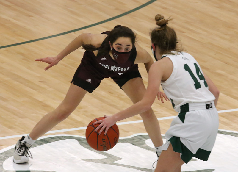 Billerica vs Chelmsford girls basketball. Chelmsford's Ellen Angwin (21) and Billerica's Julia Trainor (14). (SUN/Julia Malakie)