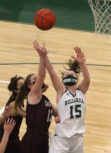 Billerica vs Chelmsford girls basketball. Chelmsford's Kathryn Slattery (12) and Billerica's Sara Macleod (15).  (SUN/Julia Malakie)