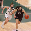 Billerica vs Chelmsford girls basketball. Billerica's Julia Trainor (14) and Chelmsford's Ellen Angwin (21). (SUN/Julia Malakie)