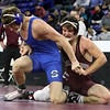 Wrestling: finals of Bossi Lowell Holiday Tournament. Joe Vecchione of Chelmsford vs Paul Calo of Southington in 170 championship match. Calo won by technical fall (17-1). (SUN/Julia Malakie)