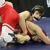 Day 2 of George Bossi Lowell Holiday Wrestling Tournament. Josh Ducharme of Tyngsboro, rear, won 9-4 over Justin Zannoti of St. John's in 138 lb Consolation of 8 #2 round.  (SUN/Julia Malakie)