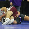 Day 2 of George Bossi Lowell Holiday Wrestling Tournament. Justin Quinton of Westford Academy, left, won 8-0 over Andre Comeau of Shawsheen Tech in 195 lb Consolation of 8 #1 round.  (SUN/Julia Malakie)