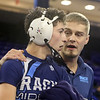 Day 2 of George Bossi Lowell Holiday Wrestling Tournament. Dracut assistant coach Mike Steward with Dante Rossetti of Dracut after Rossetti's 2-1 over Patrick Hughes of Chelmsford in 126 lb Consolation of 8 #2 round.  (SUN/Julia Malakie)