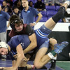 Day 2 of George Bossi Lowell Holiday Wrestling Tournament. Dante Rossetti of Dracut, front, won 2-1 over Patrick Hughes of Chelmsford in 126 lb Consolation of 8 #2 round.  (SUN/Julia Malakie)