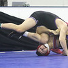 Day 2 of George Bossi Lowell Holiday Wrestling Tournament. Austin Dube of Shawsheen Tech, top, won by pin over Jack Callahan of Tewksbury in 120 lb Consolation of 8 #2 round.  (SUN/Julia Malakie)
