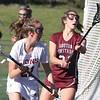 Chelmsford vs Groton-Dunstable girls lacrosse. Chelmsford's Shannon Walsh (21), left, and Groton-Dunstable's Kat Irby (21). (SUN/Julia Malakie)