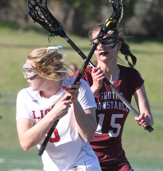 Chelmsford vs Groton-Dunstable girls lacrosse. Chelmsford's Kate Kruegar (5) and Groton-Dunstable's Abby Eisenklam (15). (SUN/Julia Malakie)