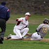 Chelmsford vs Haverhill baseball. Chelmsford shortstop Jack Beauchesne (14) tags out Haverhill's Matt Maginnis (10) trying to steal second in the top of the second inning. (SUN/Julia Malakie)