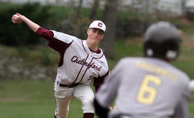 Chelmsford vs Haverhill baseball. Chelmsford's Graham Jeffries (21) pitches to Haverhill's Bryan Carter (6), attempting a bunt. (SUN/Julia Malakie)