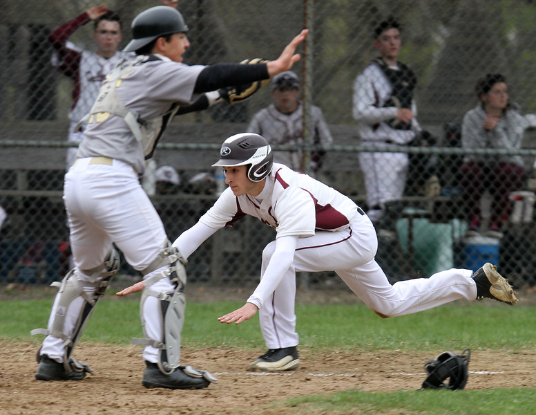 Chelmsford vs Haverhill baseball. Chelmsford's Anthony Hubbard (6) makes a diving slide past Haverhill catcher Mark Casto to score in the bottom of the third inning. (SUN/Julia Malakie)