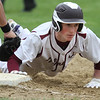 Chelmsford vs Haverhill baseball. Chelmsford's Jack Beauchesne (14) dives back safe to first in the bottom of the third inning, Haverhill first baseman Elijah Moses fielding. (SUN/Julia Malakie)