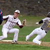 Chelmsford vs Haverhill baseball. Chelmsford shortstop Jack Beauchesne (14) fields the throw before tagging out Haverhill's Matt Maginnis (10) trying to steal second in the top of the second inning. (SUN/Julia Malakie)