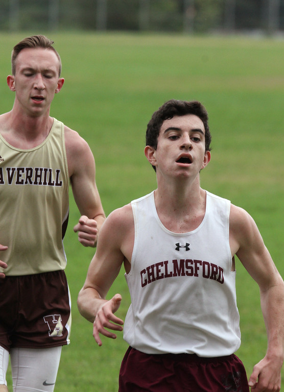 . Chelmsford vs Haverhill cross country. Aiden Hennessey of Chelmsford pulling ahead of Keith May of Haverhill on the last pass before the finish. Hennessey won and May finished 2nd. (SUN/Julia Malakie)