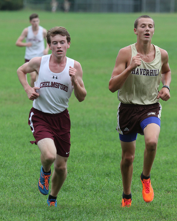 . Chelmsford vs Haverhill cross country. Ryan Hayes of Chelmsford and Andrew Harrison of Haverhill, making last pass before the finish. Hayes pulled ahead to finish 4th overall; Harrison finished 5th. (SUN/Julia Malakie)