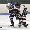 Chelmsford vs Acton-Boxboro girls hockey. Acton-Boxboro's Corlene Guenard (8) and Chelmsford's Erin Doonan (9). (SUN/Julia Malakie)